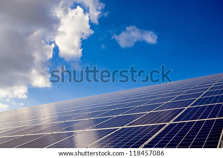 solar collector installation on a field in Germany - stock photo