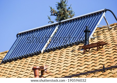solar collectors on the roof - stock photo