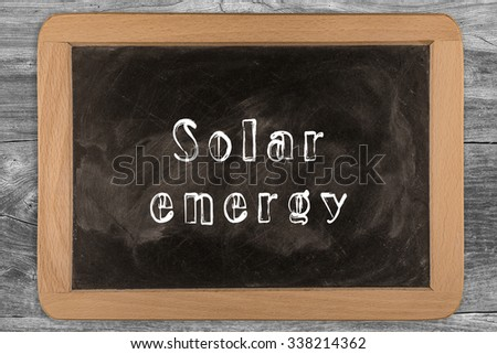 Solar energy - chalkboard with outlined text - on wood