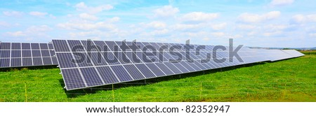 Solar energy panels against blue sky. - stock photo