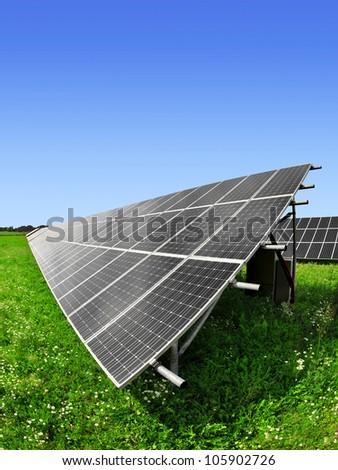 Solar energy panels against blue sky - fisheye shot - stock photo