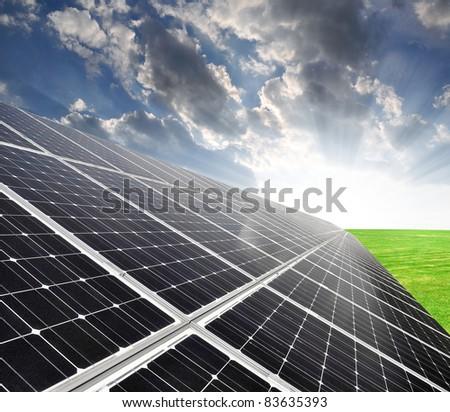 Solar energy panels against sky - stock photo