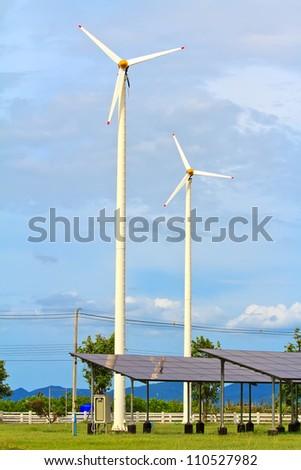 solar energy panels and wind turbine - stock photo
