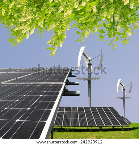 solar energy panels and wind turbines - stock photo