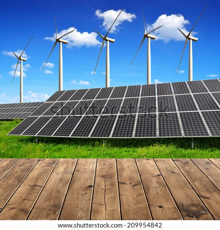 solar energy panels and wind turbines with wooden planks - stock photo