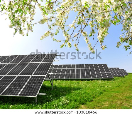 Solar energy panels in spring landscape - stock photo