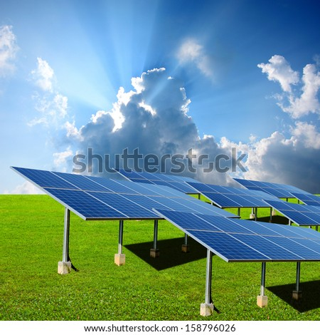 Solar energy panels in the green  - stock photo