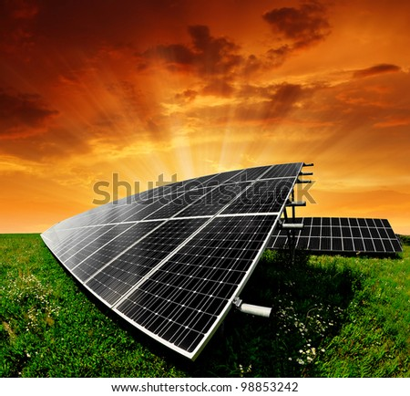 Solar energy panels in the setting sun - stock photo