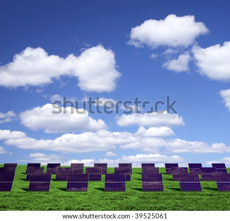 Solar energy panels on a green field - stock photo