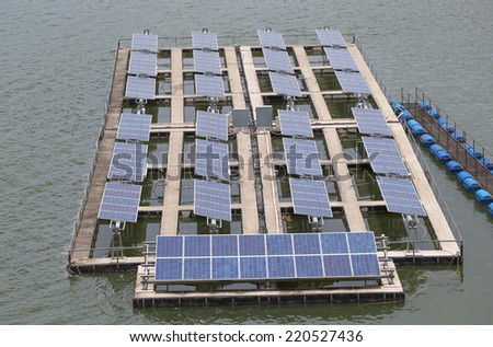 Solar energy panels on a lake  - stock photo