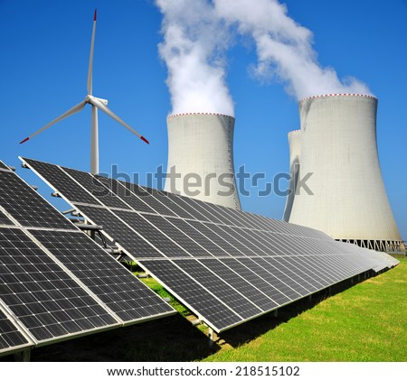 Solar energy panels, wind turbine  and nuclear power plant - stock photo