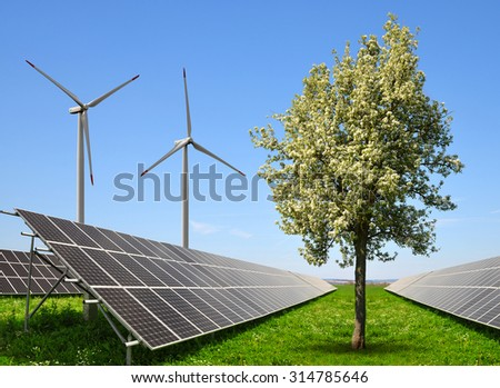 Solar energy panels with wind turbines. The concept of clean energy. - stock photo
