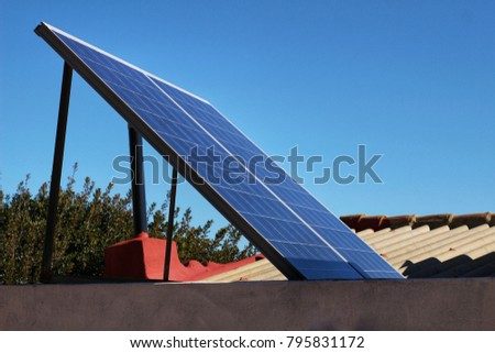Solar energy plates on the roof at home