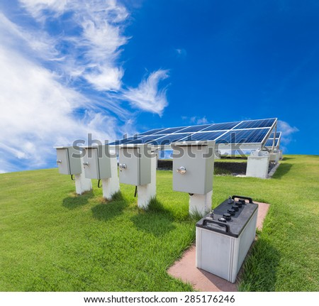 Solar energy system against blue sky - stock photo