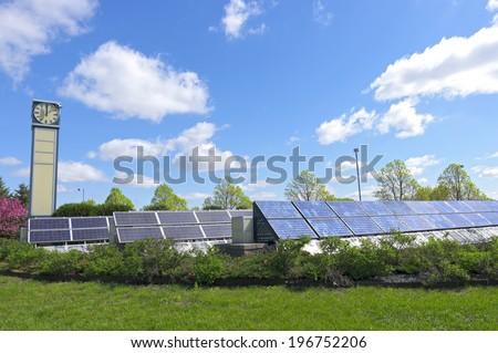 Solar garden supplies electricity at transit station in Burnsville Minnesota  - stock photo