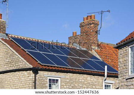 Solar heating panels. Hot water heated by the sun in a residential setting to provide domestic hot water. Solar hot water also has industrial applications, such as generating electricity.  - stock photo