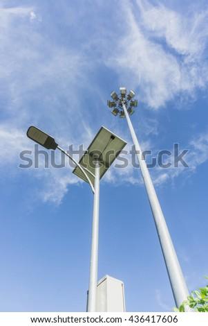 Solar Lighting and Pillar spotlights high on the sky - stock photo