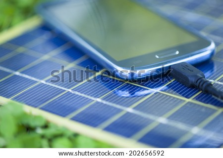 Solar Mobile Phone Chargers on grass in nature