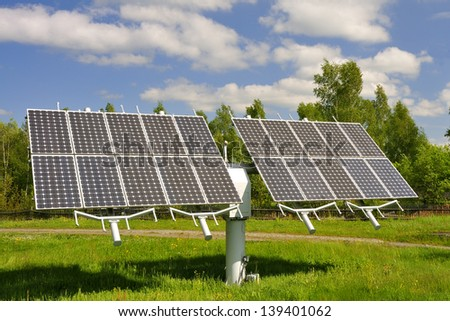 Solar module on a meadow. - stock photo