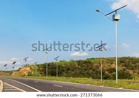 Solar modules panel on electric pole on highway in sunny day, use of Solar energy for lightning, Rio de Janeiro, Brazil - stock photo