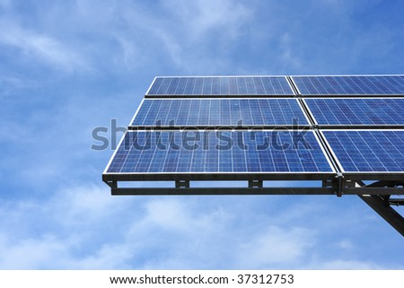 solar panel against sky with clouds