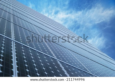 Solar Panel alternative energy technology with sky - stock photo