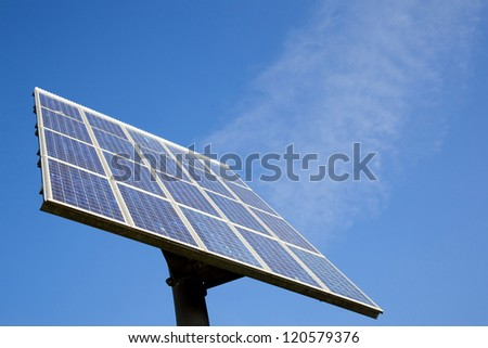 solar panel and blue sky with clouds that look like steam - stock photo