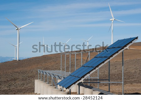 Solar panel and wind turbines - stock photo