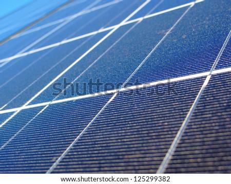 Solar panel background with shallow DOF. - stock photo