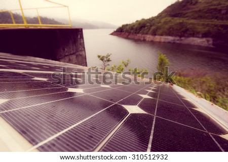 solar panel by the lake color processed - stock photo