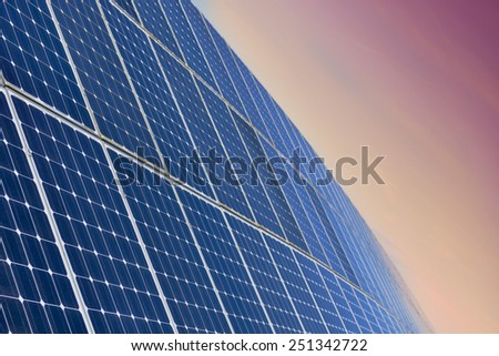 Solar Panel Field Aganinst The Sunrise - stock photo