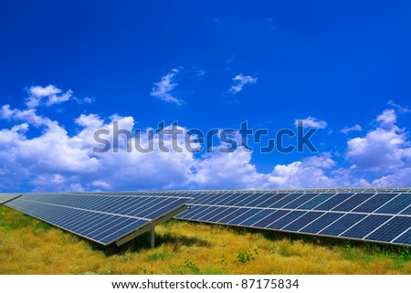 Solar panel in a field under a blue sky - stock photo