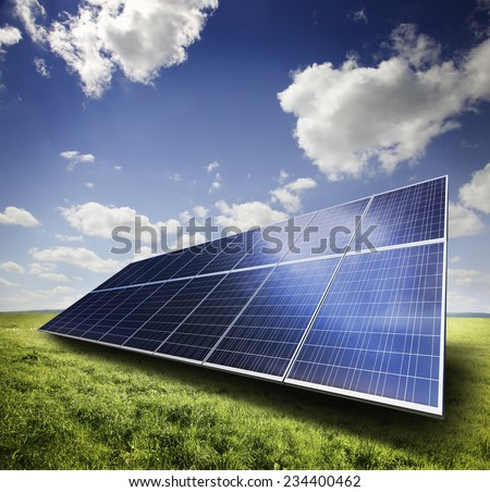 Solar panel in a green field - stock photo