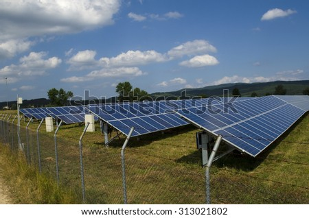 Solar panel in the field fenced in a rusty barbed wire near Sofia - stock photo