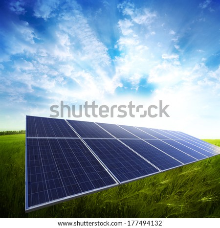 Solar panel in the green meadow - stock photo