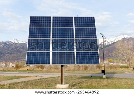 Solar panel on a background of mountains - stock photo