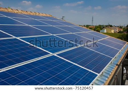 Solar panel on a house roof. Photovoltaic energy. Green energy from sun. - stock photo