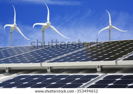 solar panel on a house with wind generators in background - stock photo
