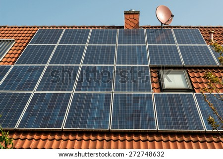 Solar panel on a red roof  - stock photo