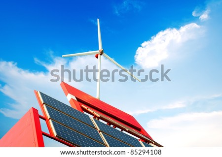 Solar panel on a red roof reflecting the sun and the cloudless blue sky - stock photo