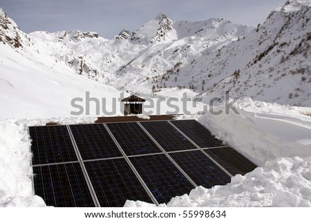 Solar panel on a roof in the mountains - stock photo