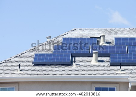 Solar panel on  roof,new house with solar panels on its roof - stock photo
