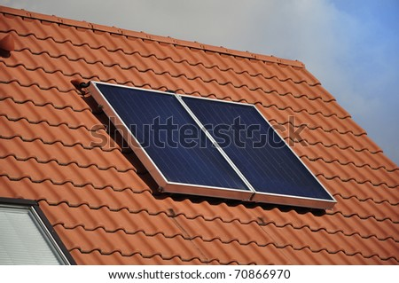 Solar panel on the roof of a private house. - stock photo