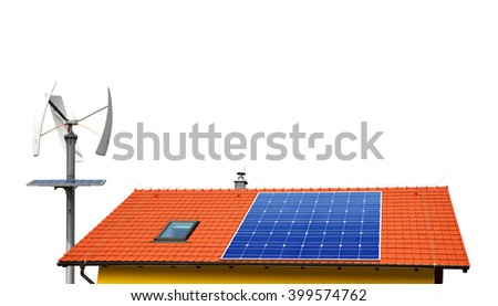 Solar panel on the roof of the house in the background wind turbines. - stock photo
