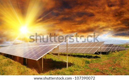 Solar panel produces green, enviromentaly friendly energy from the setting sun - stock photo