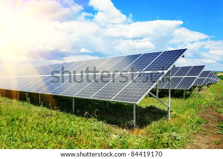 Solar panel produces green, enviromentaly friendly energy from the sun. - stock photo