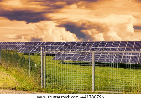 Solar panel produces green, environmentally friendly energy from the sun.Sunset sky. - stock photo
