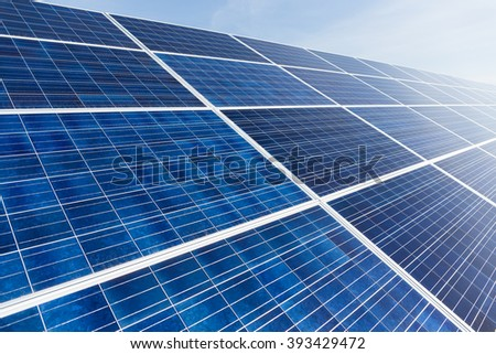 Solar panel with blue sky - stock photo