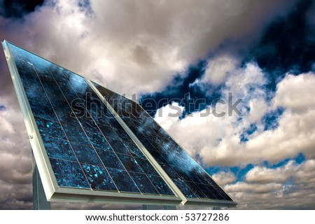 Solar panel with cloudy sky - stock photo