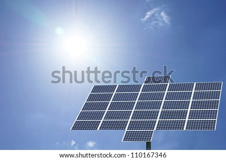 solar panel with sun and blue sky / solar panel - stock photo